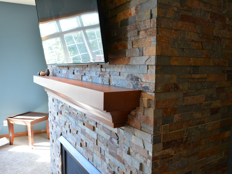brick fireplace with tv on it