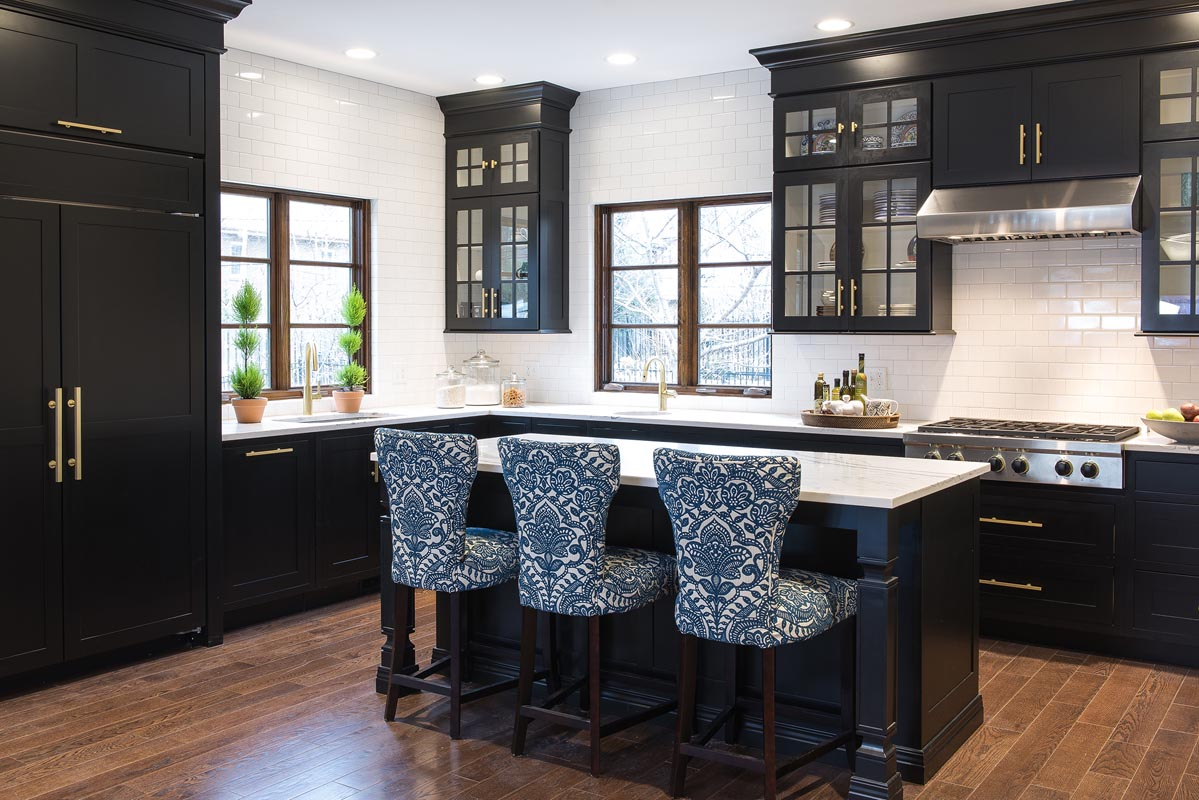 black mouser cabinets in a kitchen