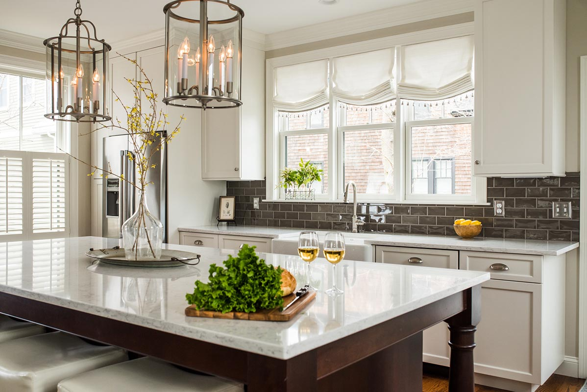white mouser cabinets near windows in a remodeled kitchen